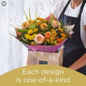 Autumn lily free hand tied bouquet made with the finest flowers